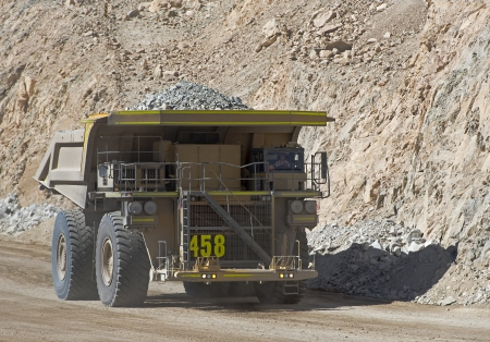 chile: Haul truck carries waste rock in the Chuquicamata copper mine