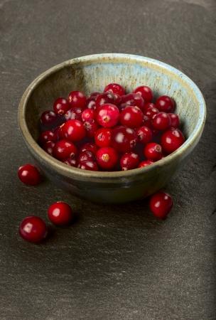 superfruit: Bowl full of fresh ripe cranberries