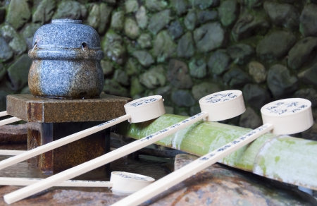 Stone water basin is a traditional element of Japanese culture  onsen, temple or garden  Reklamní fotografie
