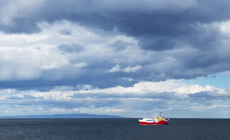 punta arenas: Small cruise ship at the Strait of Magellan  Stock Photo