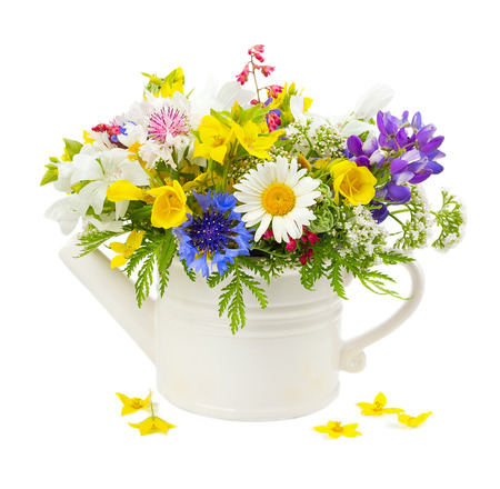 Bouquet of summer flowers in a white pot photo