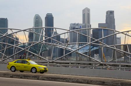 The taxi passes along pedestrian The Helix Bridge