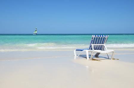strandstoel: Strandvakantie Stockfoto