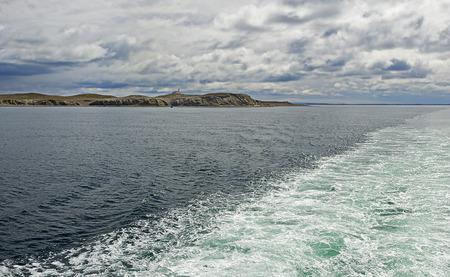 strait of magellan: Ship passes Strait of Magellan and Magdalena island