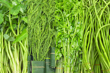 cha om: Fresh Thai greens: water spinach, cha om, fern, green beans