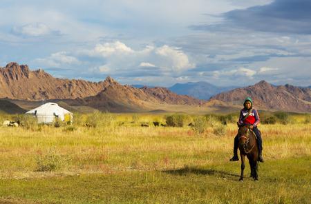 mongolia horse: Unidentified shepherd rides horse near his yurt on September 8, 2016 Mongolia. Editorial