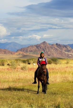 mongolia horse: Unidentified shepherd rides horse on September 8, 2016 Mongolia.