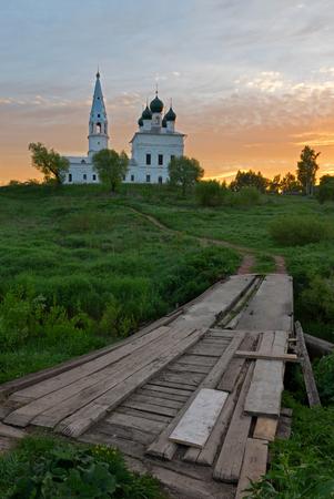 Sunrise in the tiny village Osenevo. Footpath to Kazanska church across river Lakhost.