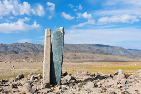 Mongolia steppe landscape. Deer stone road Tsjagaan-Go is a famous landmark of the nearby Hovd river.