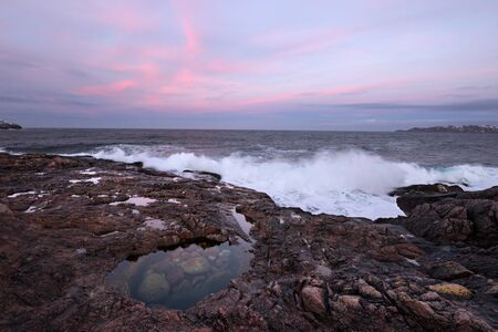 Sunset over the Barents Sea. Scenic shore nearby of Murmansk, Polar Circle.