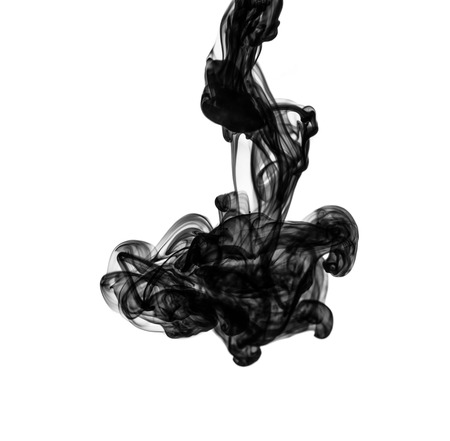 ink: Black ink dropped into water isolated on white Stock Photo
