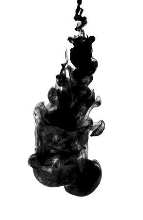 Black ink dropped into water isolated on white photo