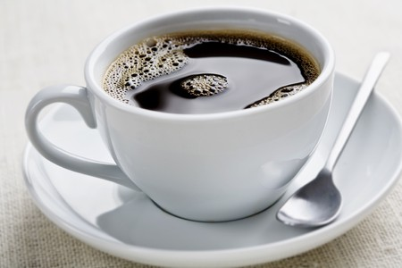 cup of freshly brewed black coffee, focus is on the middle bubbles photo