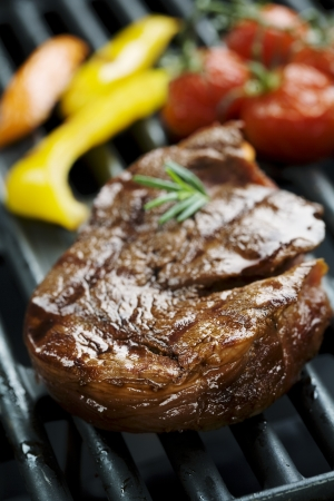 steak dinner: juicy beef fillet on the grill Stock Photo
