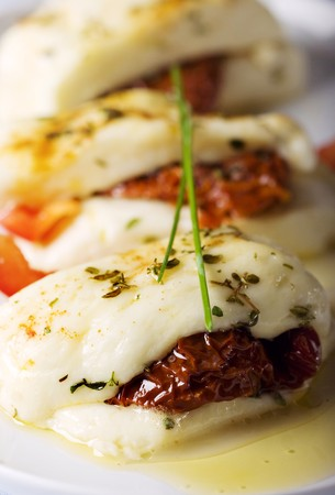 haloumi: cypriot halloumi cheese baked with garlic,herbs,sundried tomatos and red pepper