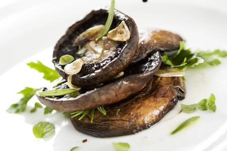 grilled portobello mushrooms, covered in herbs and garlic