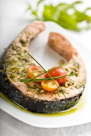 oven griiled salmon steak, covered in fresh herbs
