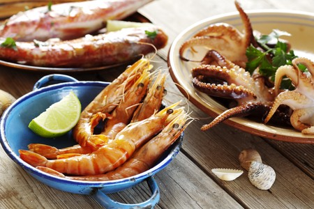 fruit platter: selection of seafood in a rustic setting Stock Photo