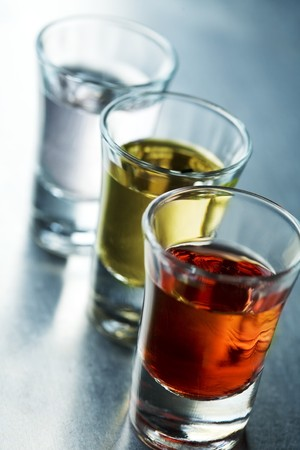 tequila: row of colorful shots Stock Photo