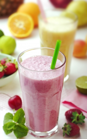 fresh smoothies surrounded by fruit