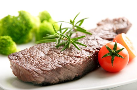 sirloin steak: tender beef fillet steak, with rosmary, baby tomatos and broccoli Stock Photo