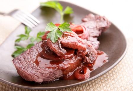 beef fillet steak in mushroom-redwine sauce, parsley as garnish