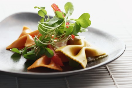 ribbon-shaped pasta with rocca and pepper