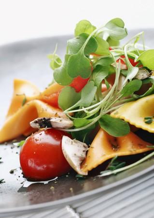 pasta salad with tomato,rocca,mushrooms,herbs Stock Photo