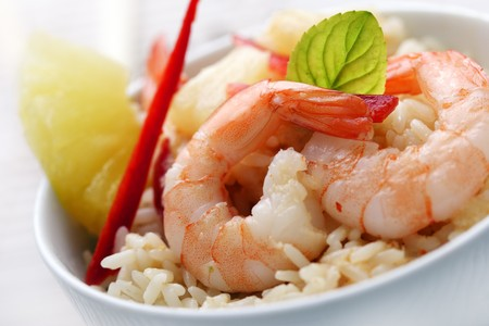 sea food: closeup of shrimps with pineapple,red pepper and rice, red curry,coconut and pineapple sauce