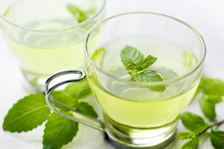 closeup of fresh mint tea, surrounded by fresh mint Stock Photo