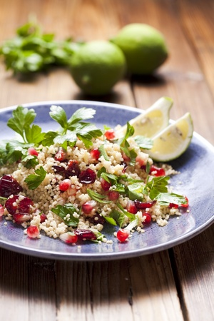 couscous salad with dried cranberries, pome-seeds and parsley Stock Photo