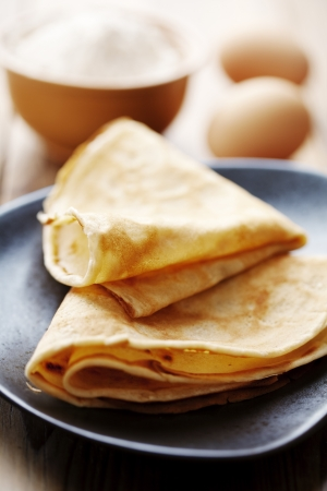 french roll: close up of two french style crepes, shallow dof. Some ingredients in the background Stock Photo