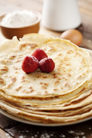 close up of two french style crepes, shallow dof. Some ingredients in the background Stock Photo