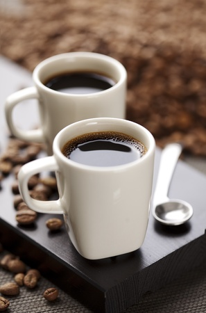 two modern espresso cups on a wooden table Stock Photo