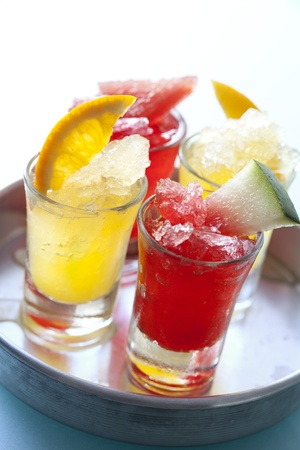 shooters: colourful icy fruit drinks on a tray