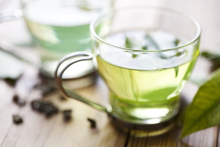 dried herb: close up of green tea or generic herbal tea, very shallow focus on the front of the cup
