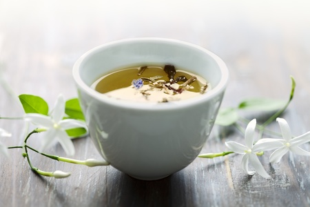 asian style tea cup with jasmin tea Stock Photo - 8955410