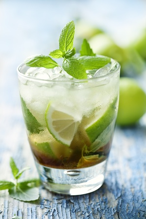 fresh mojito on a rustic table photo