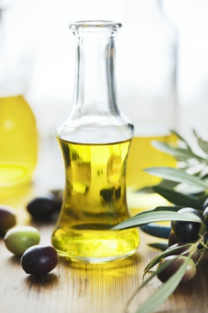 cooking oil: olive oil on wooden table
