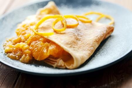opvulmateriaal: dunne, zachte crêpe met zoete oranje vulling