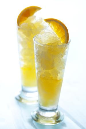 orange granitas in tall glasses Stock Photo