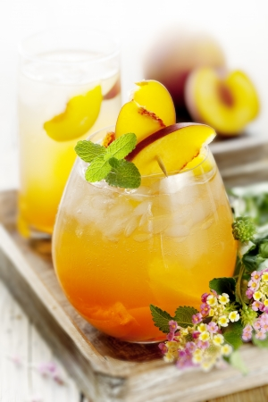 the peach: refreshing  summer cocktail, made with peach