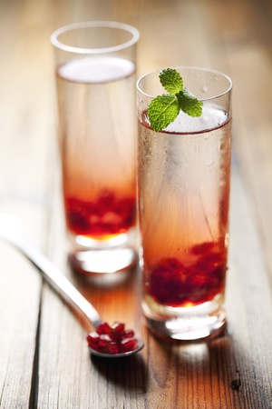 two cold pomegranate drinks or cocktails Stock Photo