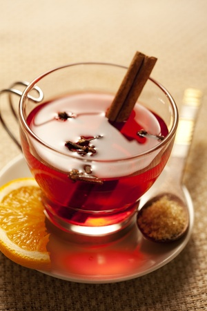 inviting warm spicy drink with ingredients photo