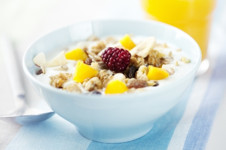 yogurt with cereal, mango and raspberry, orange juice and whole grain bagels