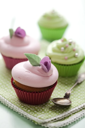 closeup of beautiful summer cupcake with strawberry flavoured cream  photo