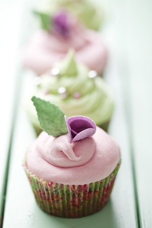 turquise: closeup of beautiful summer cupcake with strawberry flavoured cream