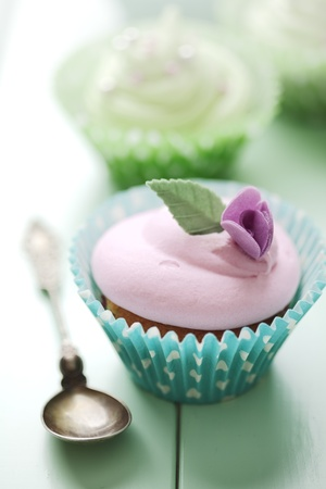 flavoured: closeup of beautiful summer cupcake with strawberry flavoured cream
