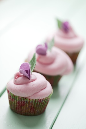 turquise: closeup of beautiful summer cupcakes with strawberry flavoured cream  Stock Photo