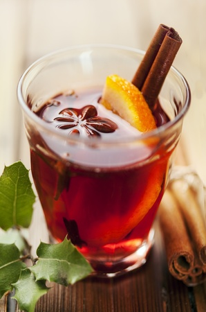 closeup of mulled wine, focus on the anise star, shallow dof photo